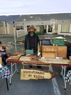 Vendors like Woodworking by Elisha participate in 3rd Saturday in the Square in Greencastle.