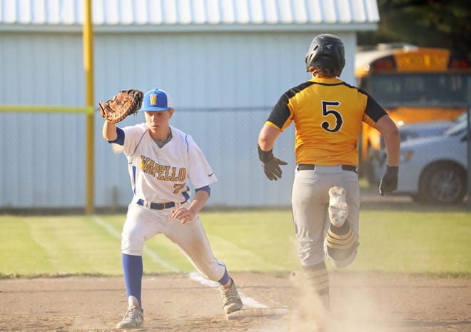 Wapello first baseman Carson Belzer makes the catch for the out on Louisa-Muscatine's Bryar Runnells.