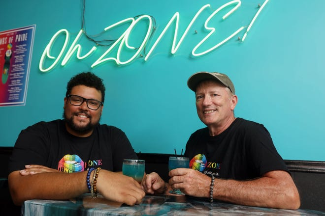 Chaz Myhre and his partner, Steve Stoll, are shown Thursday with a pair of signature cocktails at the OhZone bar that they own at 852 Washington St. in Burlington. The couple recently celebrated their 15-year anniversary last month in Cancun, Mexico. In addition to OhZone, the couple also own and operate Regal on the Hill Event Center at 1204 Washington St.