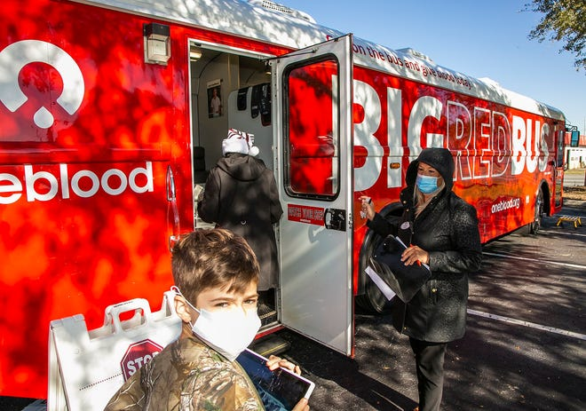Donors wait to give blood in Ocala last December. The Big Red Bus will be at Berkshire Hathaway HomeServices Florida Network Realty in Fleming Island for a blood drive on June 22.