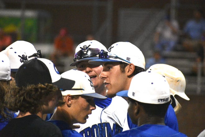 Cherryville baseball standout Dalton Pence talks with teammates before the bottom of the seventh inning Tuesday against Lincoln Charter.