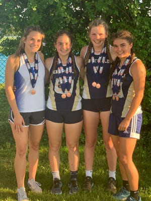 The members of Knoxville's 4x8 team (l to r :Bryn Bahnks, Mackenzie Rader, Kailee Shreeves, Kynlee Stearns) pose for a photo after taking third place in the Class 1A girls state track and field finals Thursday.