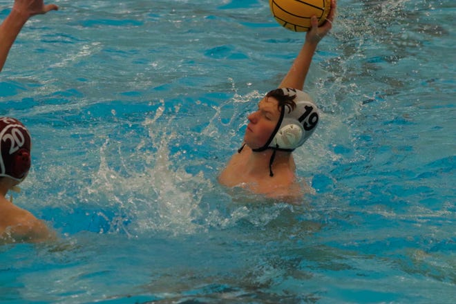 Zeeland's Nate Brinks fires a shot on net during the water polo State Championships on Friday