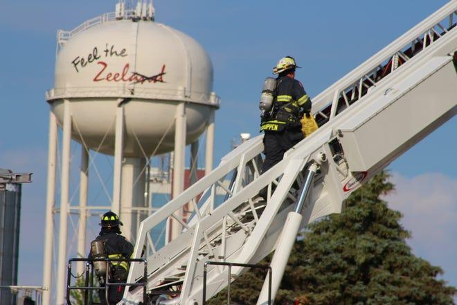 Zeeland Fire Captain Bill Gruppen Jr. climbs a ladder to investigate a fire Thursday, June 10, at the Zeeland Board of Public Works Washington Generating Facility.