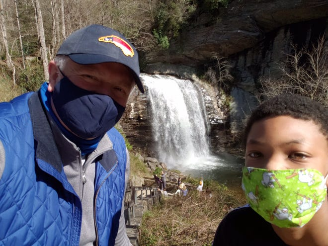 Author and BBBSWNC board member Joey Popp with Andre at Looking Glass Falls in Transylvania County.