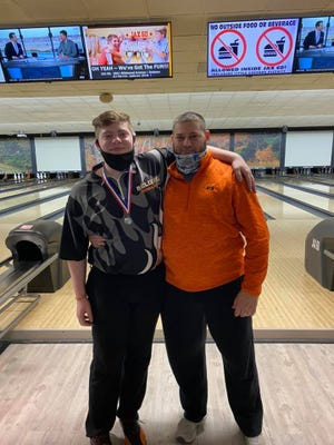 Trenton Altman (left) with his father Mark at the state bowling finals