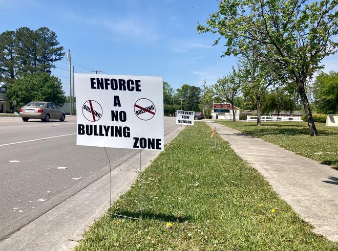A Jacksonville family led an anti-bullying protest at Living Water Christian School on Friday, April 23, in response to the school's handling of a recent incident.