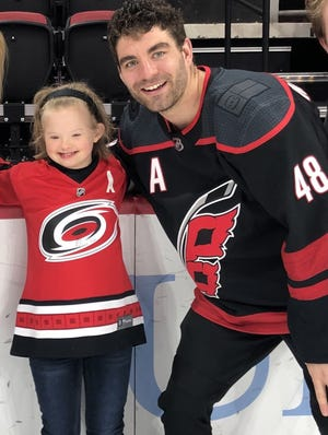 Emma Izzo calls Carolina Hurricanes player Jordan Martinook, her buddy. Their friendship has turned into a project to get Emma and her family to as many games as possible. [Contributed Photo]