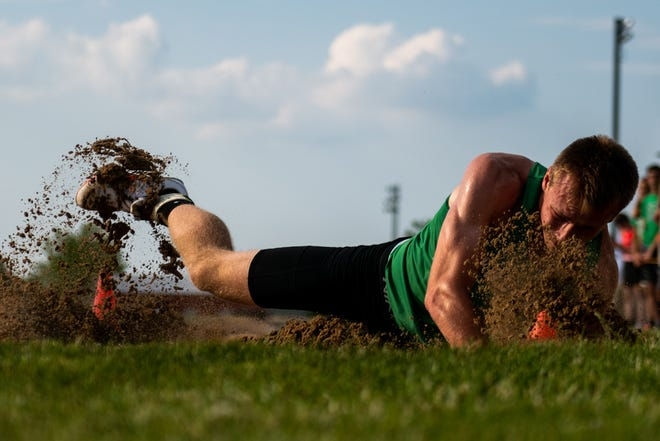 Eureka's Aden Sears lands in the sand during the long jump at the Class 2A Metamora Sectional last week. The Hornets enter the state finals as a favorite to bring home a state trophy.