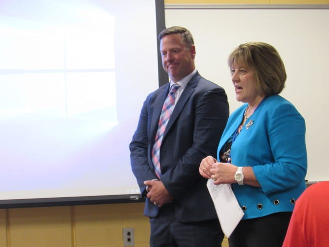 Superintendent Kathryn Powers introduces Brian Linn to the school board Thursday. Linn was hired as the new Twinsburg High School principal.