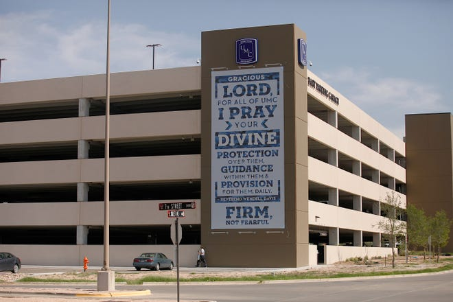 The Freedom From Religion Foundation is asking University Medical Center officials to remove a banner installed on a parking garage near the beginning of the COVID-19 pandemic saying it is an unconstitutional religious display.