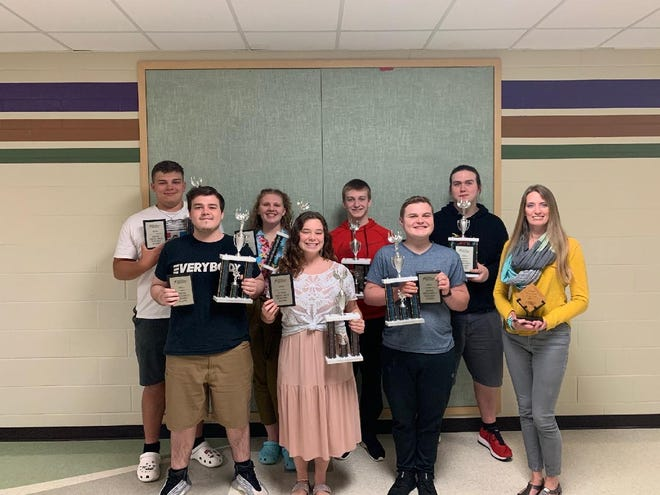 Pictured are: Wyatt Mueller, Maile Huffman, Philip Kurle, Simon Miller, Reily Dilks, Alexia Jones, Tyson Page, and head coach Emma Hantelmann who was awarded NSDA Ozark District New Coach of the Year. Not pictured, Chase Pollak.
