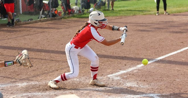Gracie Brinkerhoff drops a bunt for New Boston Huron's softball team. Huron didn't use the bunt much during the regular season, but needed it last week to win its District Tournament. Huron, Flat Rock St. Mary Catholic Central and Whiteford all expect to use the bunt as a weapon in Regional Tournaments Saturday.