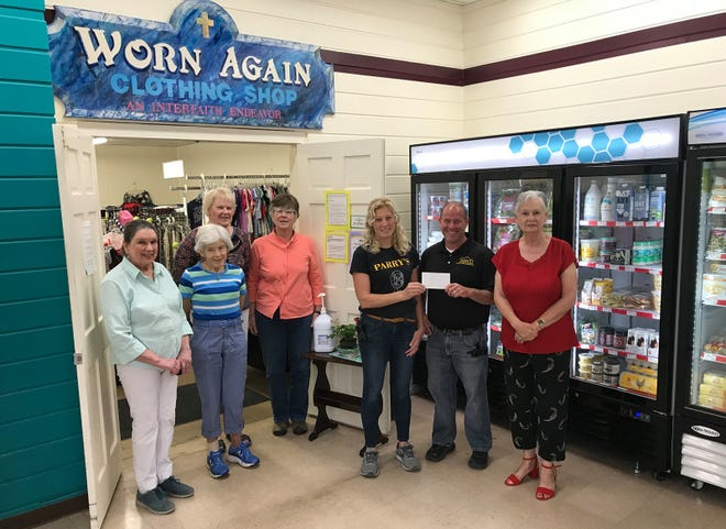 Officers of the Worn Again Clothing Shop thanked their hosts Gwenn and Evan Werner with a gift certificate June 11 for allowing them to keep their space at Parry's General Store in Hamilton. From left are Worn Again corresponding secretary Jean Chapin, secretary Debbie Kliman, vice president Jen Follett, treasurer Pam Fuller, Gwenn and Evan Werner and Worn Again president Barb Albrecht.
