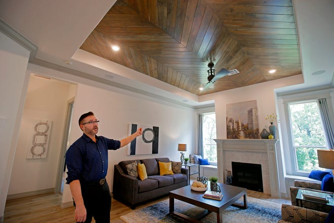 Philip Green, with Authentic Custom Homes, shows features in the living room of a model home at 2408 Asaro Lane in Edmond.