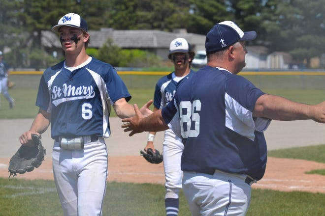 Brody Jeffers (6), head coach Matt Nowicki (right) and the rest of the Snowbirds continued to roll when they met Rogers City to open regionals.
