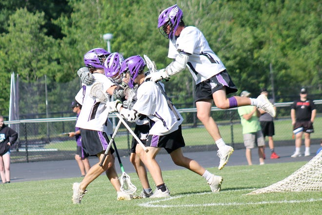 The Marshwood High School boys lacrosse team celebrates one of its 10 goals during Thursday's playoff win over Kennebunk in South Berwick, Maine.