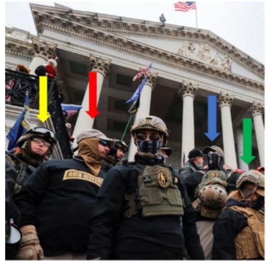 """On January 6, Jason Dolan (with the red arrow) was wearing a black """"Oath Keepers"""" t-shirt while standing on the steps of the Capitol, according to this photo from the FBI."""