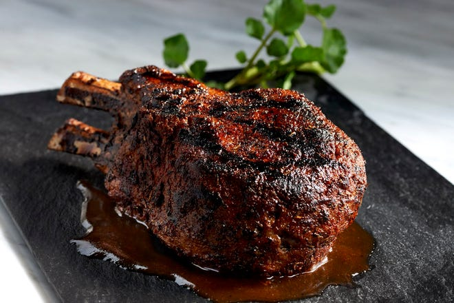 Morton's the Steakhouse offers a double-cut prime pork chop on its holiday specials menu.