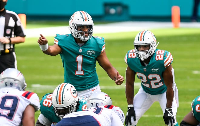 Dolphins quarterback Tua Tagovailoa calls an audible against the Patriots during their game at Hard Rock Stadium last December.