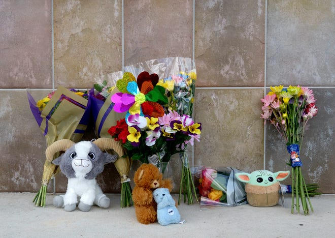A small memorial is set up at the Publix in Royal Palm Beach Friday morning, June 11, 2021, where a man shot and killed a woman and her grandson Thursday before killing himself.