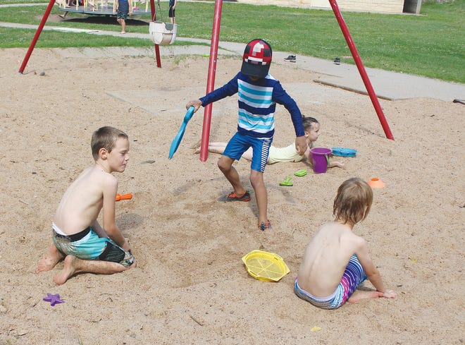 Three Pratt boys work on burying treasure at Zerger Park during Pratt Rec summer activities.