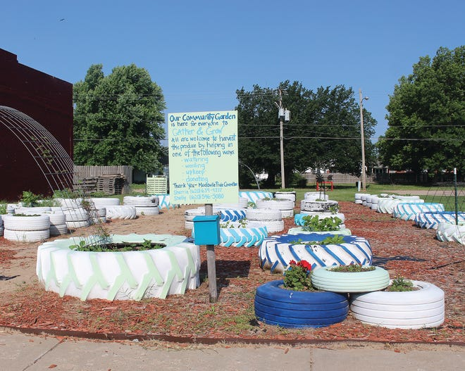 Possibly 100 recycled tires now serve as plant pots in Macksville's thriving community garden downtown.