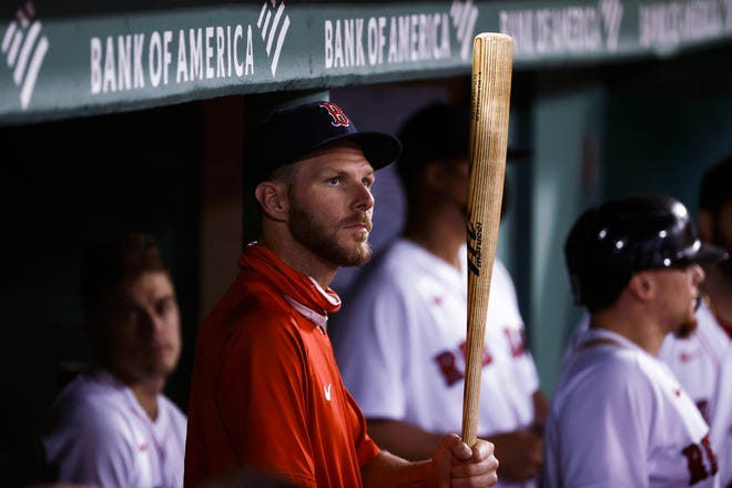 Red Sox pitcher Chris Sale watches from the dugout as he teammates play the Houston Astros on Tuesday night.