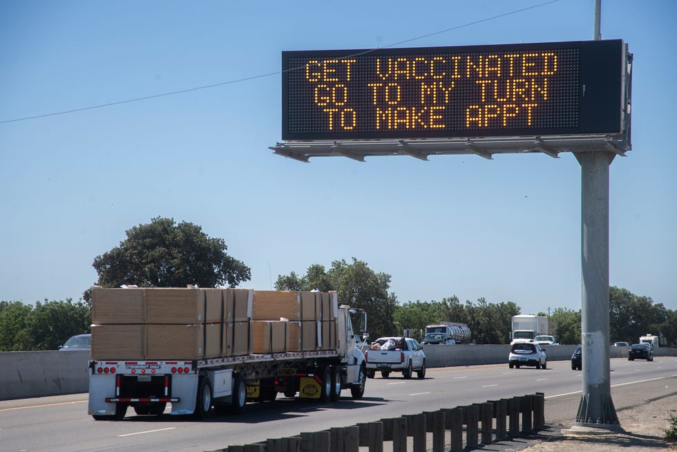 An electronic message board on Highway 99 near French Camp Road in Stockton urges drivers to get their COVID-19 vaccinations.