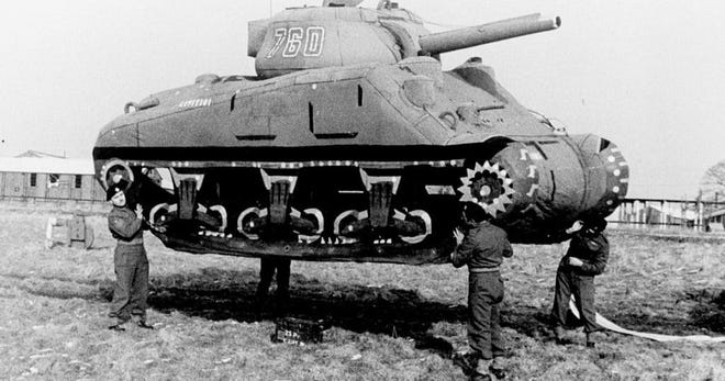 Four Soldiers assigned to the 23rd Headquarters Special Troops — commonly referred to as the Ghost Army — move an inflatable tank. The 1,100 Ghost Army service members used a variety of unique deception tactics to fool the enemy in World War II. Besides inflatable dummy equipment, they incorporated sound effects, radio trickery and impersonation. Their efforts were classified until 1993, but are now being highlighted and taught via the Ghost Army Legacy Project. (Photo courtesy of the National Archives/Fort Leonard Wood)