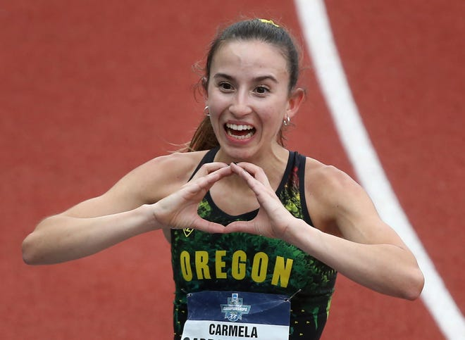 Oregon's Carmela Cardama Baez celebrates her victory in the 10,000 meters during the NCAA Outdoor Track & Field Championships at Hayward Field on Thursday.