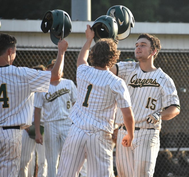 Crest's Jackson Ledbetter is congratulated by teammates Connor Gantt and Ben Hodge following a home run against Kings Mountain on Thrusday.