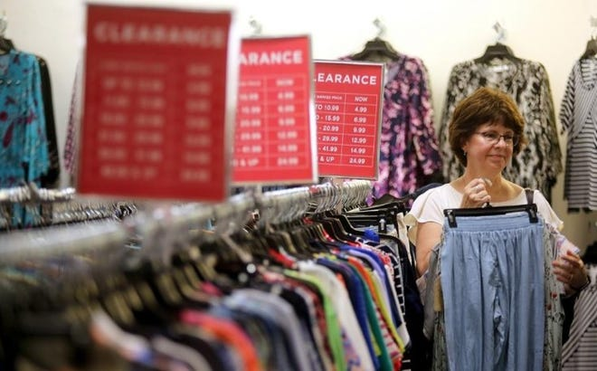 Pam Buchanan looks through the racks at Belk in Cleveland Mall in this Star file photo.