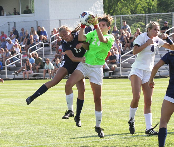 Three Rivers goalie Alaina Todd makes a leaping save against Unity Christian in the regional finals on Thursday.