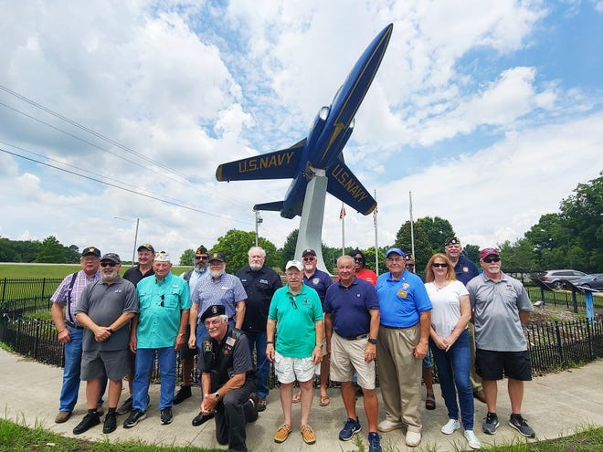 Representatives of groups that benefitted from 'Wall That Heals' fundraising recently traveled to Lawson Creek for a group photo to mark the occasion.