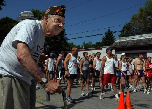 Runners line up for the Leonide J. Lemire 4.9-Mile Road Race in 2000, when the former VFW Post 6055 conducted the event.