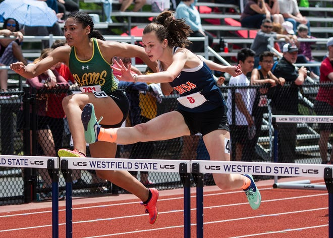 AMSA's Alison Silva, shown competing in the 110 hurdles during the Division 2 Central/West Championships at Westfield State University in 2019, won two events on Thursday to help the Eagles win the league championship.