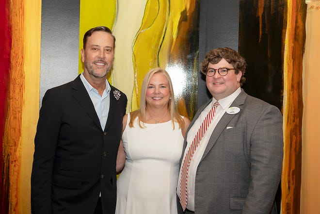 """Artist Shane Pennington, Gadsden native Beverly Phillips and Hardin Center Director Tom Banks are pictured Thursday at a reception for the donation of artwork by Pennington that was commissioned by Phillips' late brother, Robert """"Bobby"""" Bugg, also a Gadsden native, to a permanent collection at the center."""