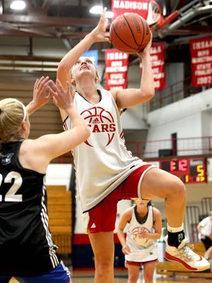 BNL junior forward Mallory Pride spins inside to score in the Lady Stars' 48-35 win over Charlestown Thursday night in scrimmage action at BNL Fieldhouse.