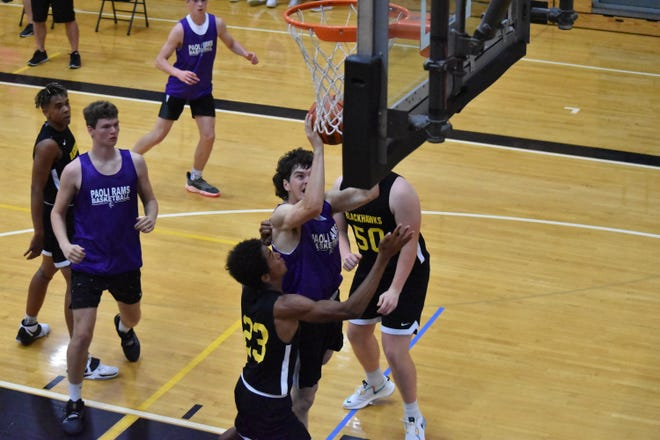 Paoli's Carson Little attacking the rim against Springs Valley