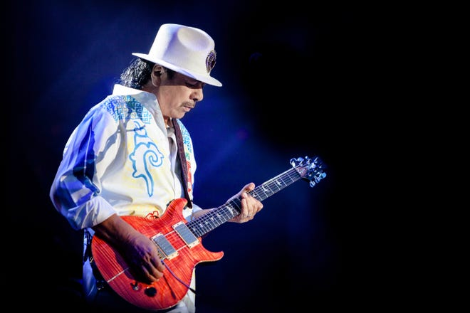 Carlos Santana, shown here from a live show in 2013, will bring the band that bears his name to the Tuscaloosa Amphitheater on Friday.
