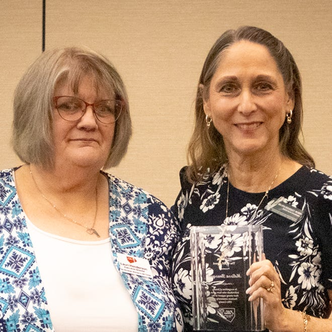 Ellis Christian Women's Job Corps executive director Lauri Henderson (left) presents the 2021 ROSE Award to Waxahachie ISD Director of Health and Wellness Melissa Bousquet.