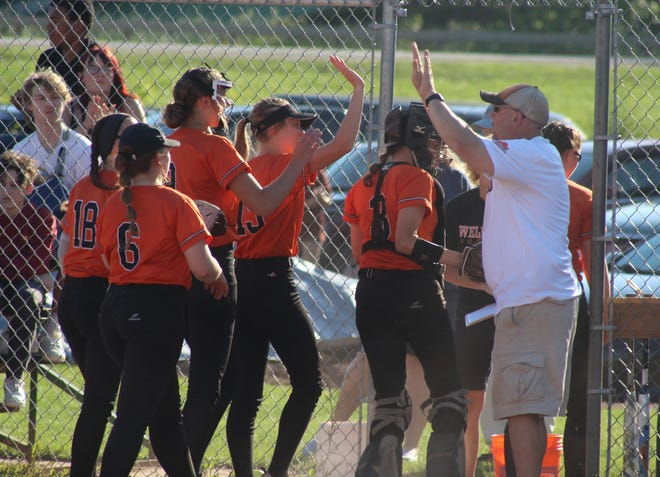 The Lady Lions high-five head coach Matt Burke as they leave the field during Thursday's Section V quarterfinal win over Mynderse.