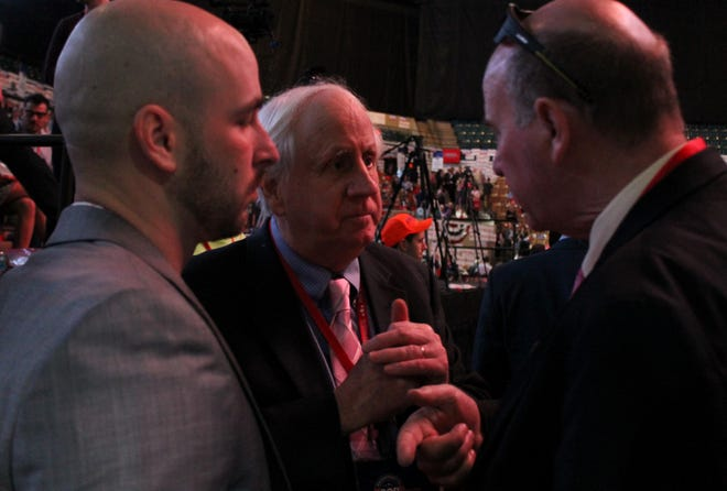 Jim Lyons, center, who now chairs the state Republican Party, confers with fellow delegates including Rep. Marc Lombardo, left, at the party's 2018 convention.