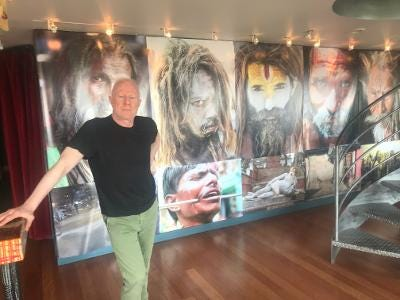 Bobby Sager pictured at his home in front of some of his photos.