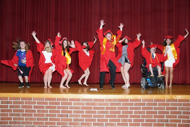 """Senior members of the Hudson High School Drama Society gathered on the stage of the Paul """"Skip"""" Johnson Memorial auditorium at the school for their last school performance. Pictured, from left: Arthur """"A.J"""" Metherall, Baily Bourgeois, Julia Stukonis, Lauren Lattanzi, Ilan Levine, Kayla Popovich, Jake Marrazzo and Maia Fras."""
