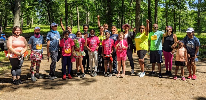 Girls on the Run team, coaches, running buddies, Congresswoman Ayanna Pressley, Randolph police detective, Randolph firefighters, Randolph health worker and volunteers give a cheer t the inaugural 5K.
