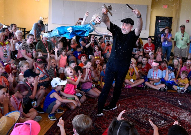 """Amid soap-bubble """"snow"""", Kent Williams of Gepetto's Marionette Theater entertains children at Elks Art Center during Friday's Children's Art & Literacy Festival. The event continues Saturday in downtown Abilene."""