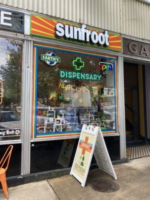 The front of SunFroot, a dispensary in Downtown Asheville