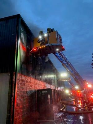 Fire crews battle a blaze at Public Storage on Kitsap Way Friday morning.